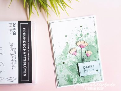 Aquarellkarte mit Freundschaftsblüten